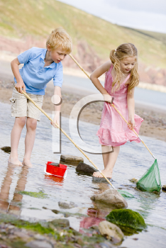 Royalty Free Photo of a Boy and Girl at the Beach