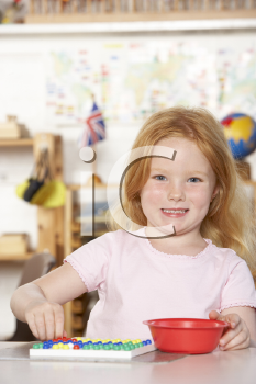 Royalty Free Photo of a Little Girl at Playschool