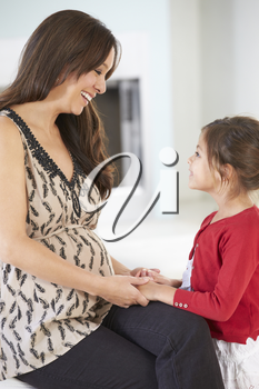 Pregnant Mother With Daughter At Home