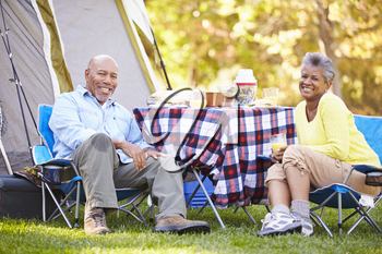 Senior Couple Enjoying Camping Holiday In Countryside
