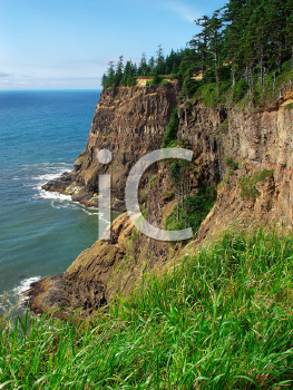 Royalty Free Photo of a Rugged Coastline at Cape Meares Scenic Viewpoint in Oregon