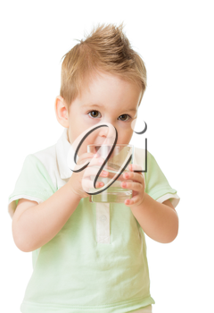 Boy drinking water from glass isolated on white