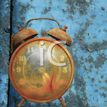 Royalty Free Photo of an Old Alarm Clock Against a Rusty Blue Metal Background