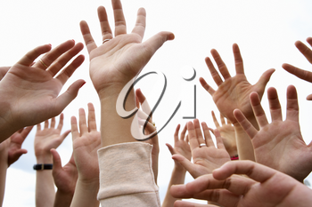 Detail young people's hands in air