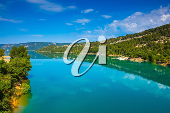 Verdon Canyon, the biggest in the French Alps. Spring Provence. Azure water reflects the clouds