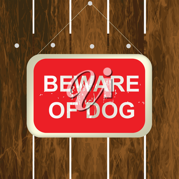 Beware of a dog sign on a wooden fence
