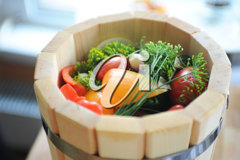 preserved tomatoes, cucumbers, peppers in wooden jar
