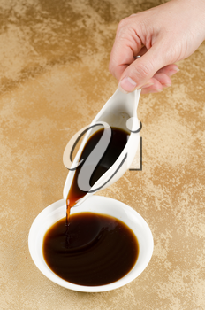 Female woman pouring soy sauce