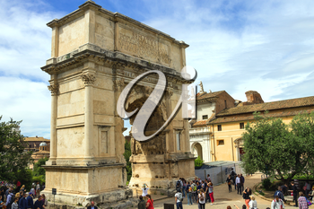 ROME, ITALY - MAY 04, 2014: Tourists in square near the Triumphal Arch of Titus in Rome, Italy