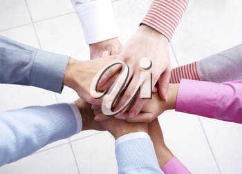 Close-up of business people�s hands on top of each other